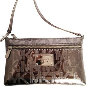 Michael Kors metallic wristlet in nickel